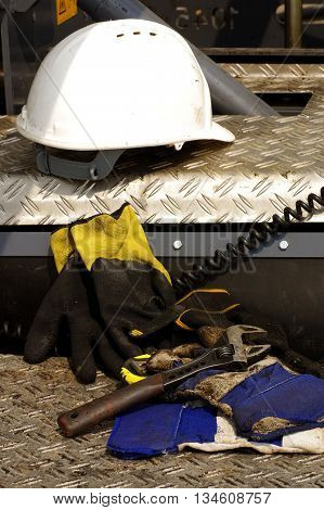 Hard hat adjustable wrench protective gloves construction detail.
