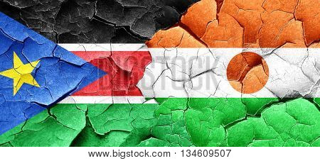 south sudan flag with Niger flag on a grunge cracked wall