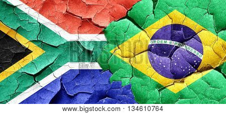 South africa flag with Brazil flag on a grunge cracked wall