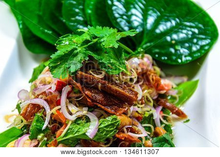 one of dish thai food enjoy the taste of sour spicy salad many apply from meat eating with chaplo leave