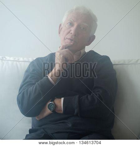 Sad Man Sitting On The Sofa