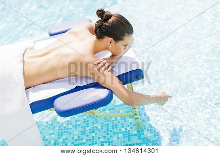 Pretty Young Woman Relaxing At Massage Table
