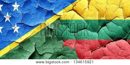 Solomon islands flag with Lithuania flag on a grunge cracked wal