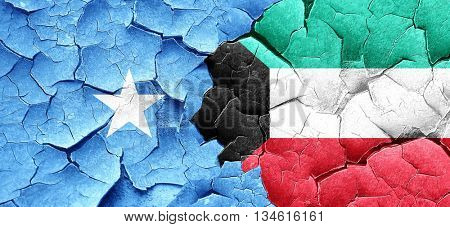 Somalia flag with Kuwait flag on a grunge cracked wall