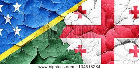 Solomon islands flag with Georgia flag on a grunge cracked wall