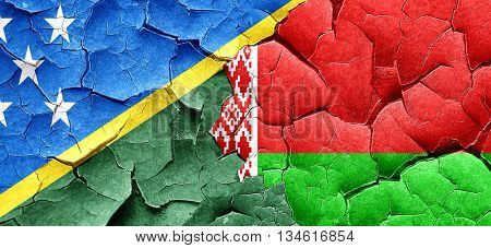 Solomon islands flag with Belarus flag on a grunge cracked wall