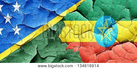 Solomon islands flag with Ethiopia flag on a grunge cracked wall
