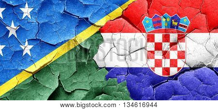 Solomon islands flag with Croatia flag on a grunge cracked wall
