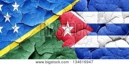 Solomon islands flag with cuba flag on a grunge cracked wall