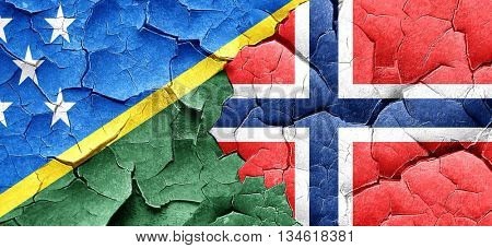 Solomon islands flag with Norway flag on a grunge cracked wall