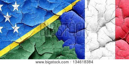 Solomon islands flag with France flag on a grunge cracked wall