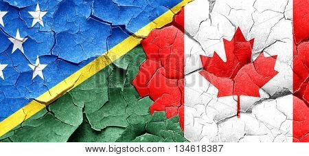 Solomon islands flag with Canada flag on a grunge cracked wall