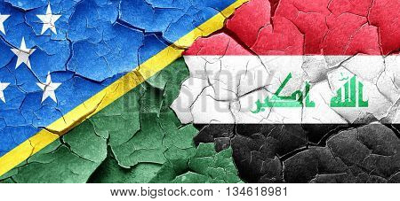 Solomon islands flag with Iraq flag on a grunge cracked wall