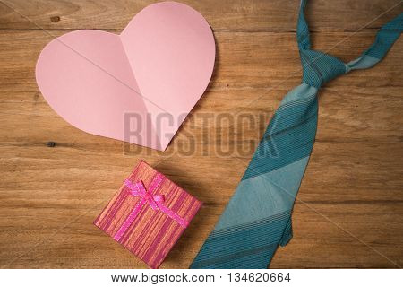 Daddy's Textile hearts gift and blue necktie on wooden background .fathers day concept