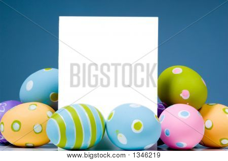 Brightly Colored Easter Eggs Surrounding White, Blank Notecard