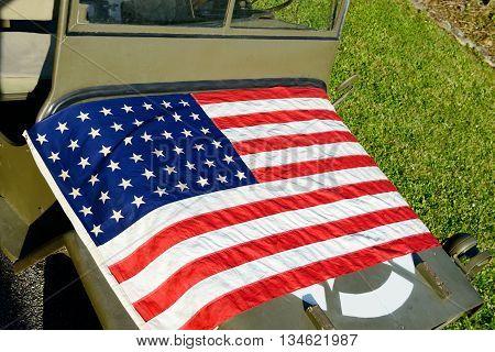 a ww2 military vehicle jeepwith American flag