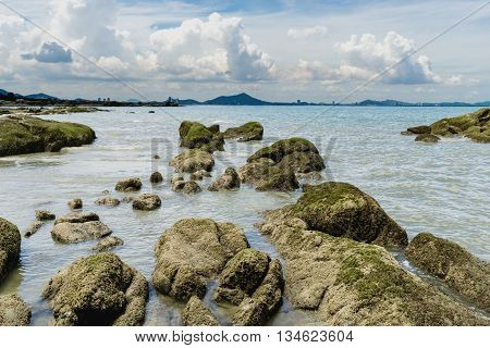 Seascape with stone and blue sky with clouds in sunny day Seascape from Thailand