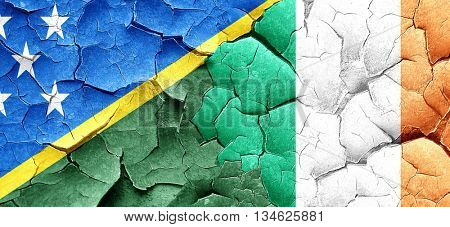 Solomon islands flag with Ireland flag on a grunge cracked wall
