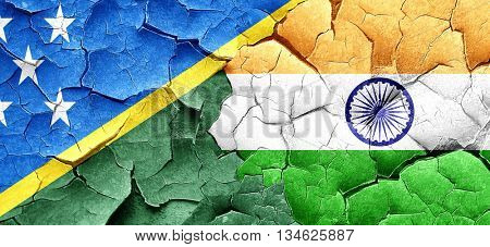 Solomon islands flag with India flag on a grunge cracked wall