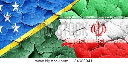 Solomon islands flag with Iran flag on a grunge cracked wall