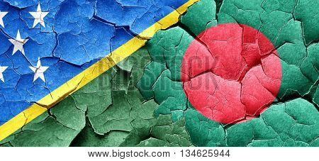 Solomon islands flag with Bangladesh flag on a grunge cracked wa
