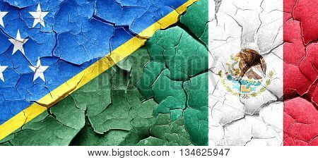 Solomon islands flag with Mexico flag on a grunge cracked wall