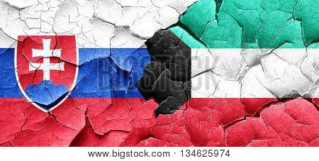 Slovakia flag with Kuwait flag on a grunge cracked wall
