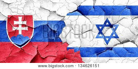 Slovakia flag with Israel flag on a grunge cracked wall