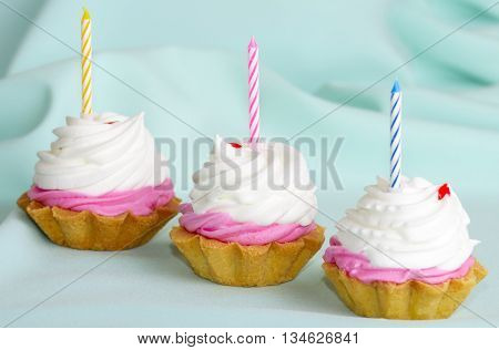 Cream cake with candles on the birthday
