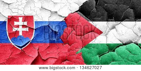 Slovakia flag with Palestine flag on a grunge cracked wall