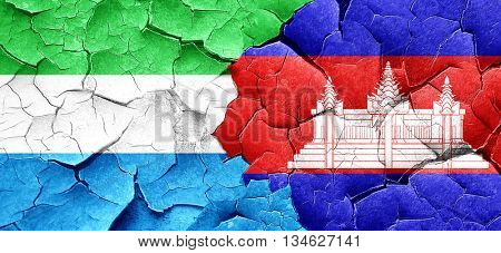 Sierra Leone flag with Cambodia flag on a grunge cracked wall
