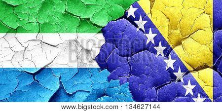 Sierra Leone flag with Bosnia and Herzegovina flag on a grunge c