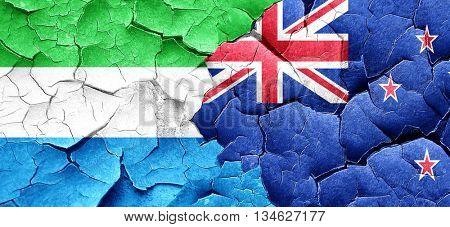 Sierra Leone flag with New Zealand flag on a grunge cracked wall