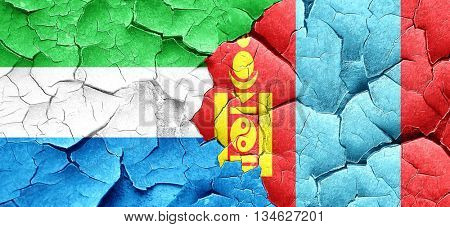 Sierra Leone flag with Mongolia flag on a grunge cracked wall