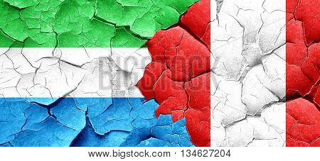 Sierra Leone flag with Peru flag on a grunge cracked wall