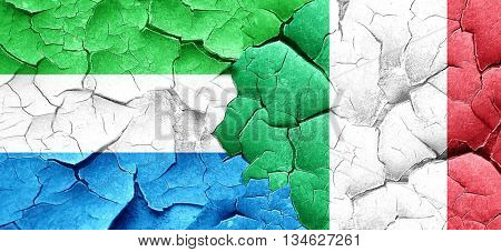 Sierra Leone flag with Italy flag on a grunge cracked wall