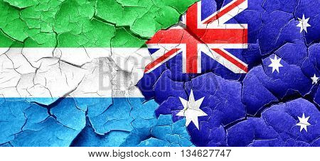 Sierra Leone flag with Australia flag on a grunge cracked wall