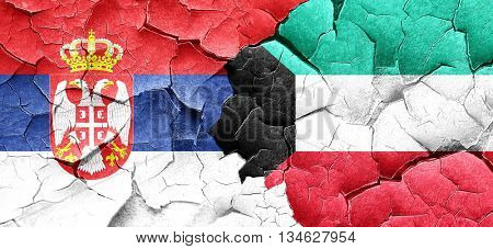 Serbia flag with Kuwait flag on a grunge cracked wall