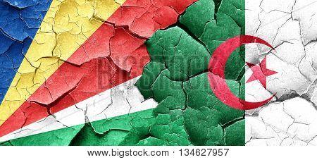 seychelles flag with Algeria flag on a grunge cracked wall