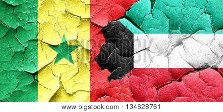 Senegal flag with Kuwait flag on a grunge cracked wall