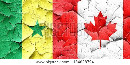 Senegal flag with Canada flag on a grunge cracked wall