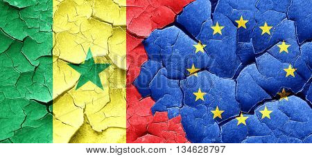 Senegal flag with european union flag on a grunge cracked wall