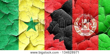 Senegal flag with afghanistan flag on a grunge cracked wall