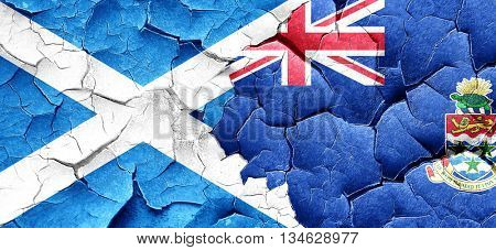 scotland flag with Cayman islands flag on a grunge cracked wall