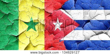 Senegal flag with cuba flag on a grunge cracked wall