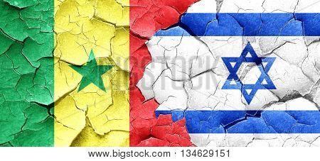 Senegal flag with Israel flag on a grunge cracked wall