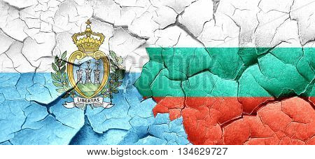 san marino flag with Bulgaria flag on a grunge cracked wall