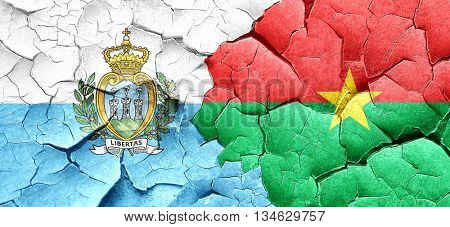 san marino flag with Burkina Faso flag on a grunge cracked wall
