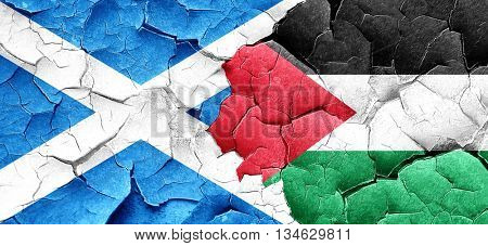 scotland flag with Palestine flag on a grunge cracked wall