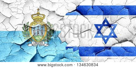 san marino flag with Israel flag on a grunge cracked wall